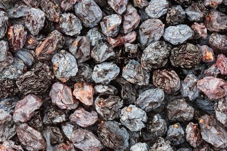 background close up of sun dried raisins Stock Photo