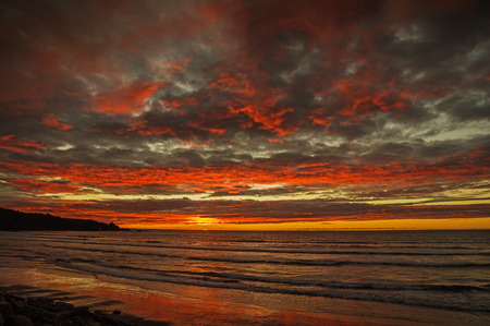sunset over the Pacific Ocean in Punakaiki New Zealand