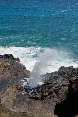Halona Blowhole spouting spray on Oahu Hawaii