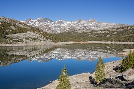 reflection of mountains in Waugh Lake with a low water level because of the California drought Stock Photo