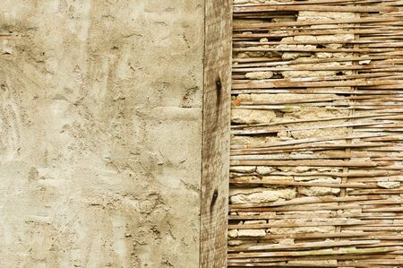 half broken bamboo lath and stucco wall in Thailand Stock Photo