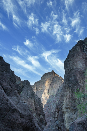 blue sky with wispy clouds over White Rock Canyon in Arizona