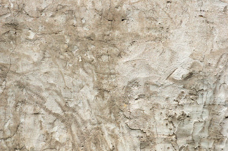 old gray cracked stucco wall background texture