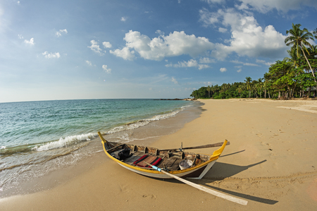 rowboat on a tropical beach in Koh Lanta Thailand