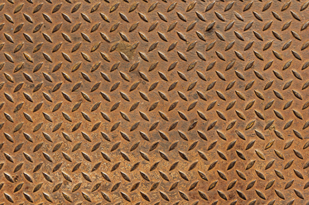 old rusty diamond tread non skid metal plate background Stock Photo