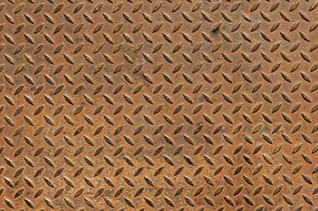 skid: old rusty diamond tread non skid metal plate background Stock Photo