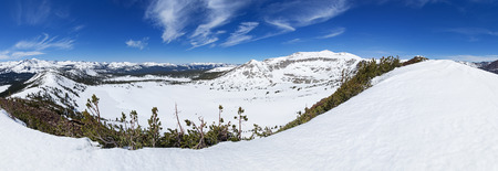 panorama of a snowy Tuolumne Meadows Yosemite High country from Gaylor Peak near Tioga Pass