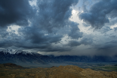 a spring storm comes in over the Eastern Sierra over the Owens Valley Banco de Imagens