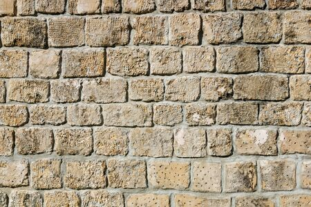 old dressed stone wall background texture Stock Photo