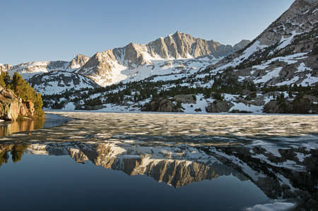 long lake: reflection of Mount Goode in the Sierra Nevada mountains reflected in long lake as the ice melts in the spring Stock Photo