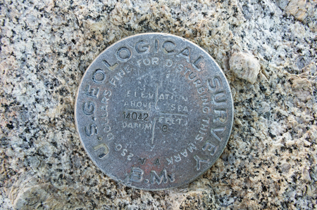 Mount Langley USGS bench mark with elevation 14042 ft marked