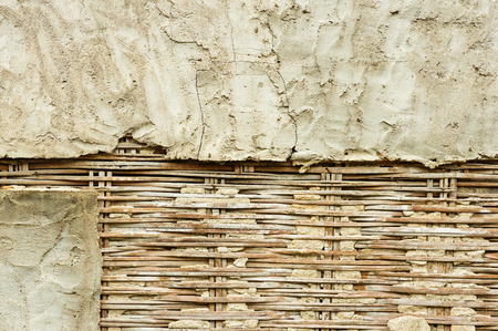 old bamboo lath and plaster wall falling apart