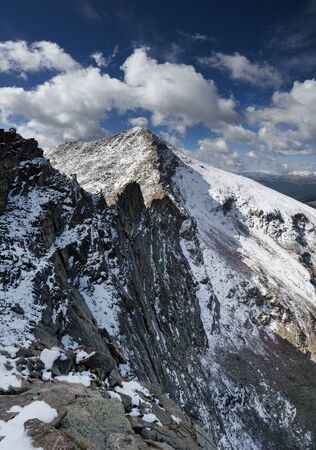 Mount Bierstadt in Colorado from near the Sawtooth Mountain with steep cliff on the north side and fresh snow