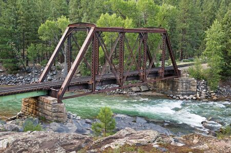 narrow gauge railroad bridge over the Animas River in Colorado Stock Photo