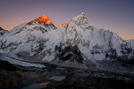 last light hitting the highest peaks of Everest, Lhotse, and Nuptse in Nepal from Kala Patthar Stock Photo