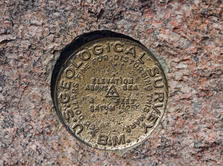 Benchmark on the 14255 foot summit of Longs Peak in Rocky Mountain National Park