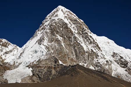 Pumori or Pumo Ri a 7161 meter mountain in the Everest region of the Himalaya with Kala Patthar below it