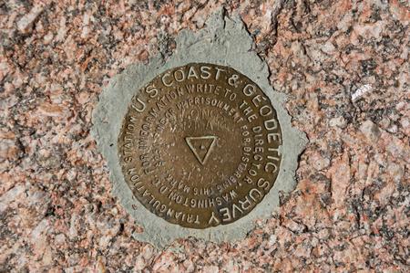 longs peak: the triangulation point survey marker on the summit of Longs Peak in Rocky Mountain National Park