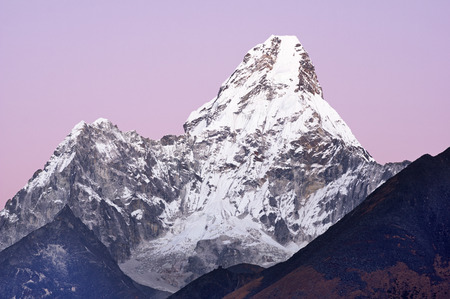 6170 meter tall Ama Dablam Mountain as seen from Tengboche Monastary just after sunset with pale purple sky