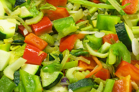 angled background view of frying mixed vegetables