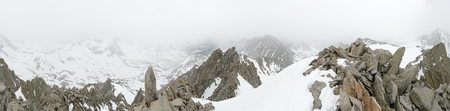 foggy and snowy 360 degree mountain top panorama from the summit of Picture Puzzle Peak in the Sierra Nevada Mountains near Bishop California