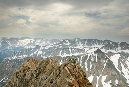 a man in the distance climbing the ridge of Mount Emerson in the Sierra Nevada Mountains Stock Photo