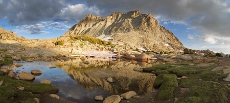 mountain reflection in a small lake on Darwin Bench in the Sierra Nevada Mountains