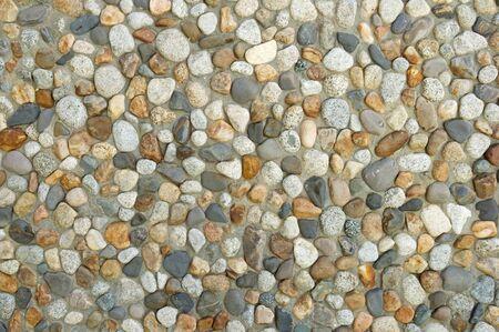 洗浄したコブルテクスチャの背景を持つコンクリート壁