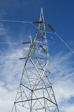metal electric high power line tower with sky background