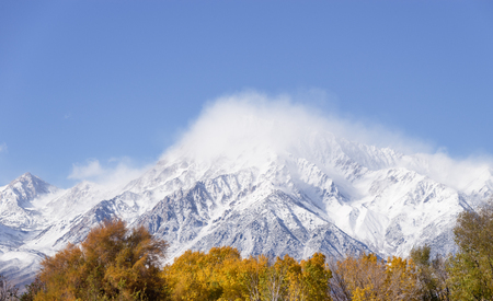 clouds rise to reveal Mount Tom with fresh snow