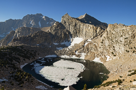 Big Pothole Lake Nameless Pyramid University Peak and Snow Crown Mountain from near Kearsarge Pass in the Sierra Nevada Mountains of California