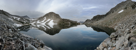 panorama of Golden Lake in the Sierra Nevada Mountains of California on a cloudy day