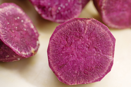 cut and trimmed pieces of purple sweet potato with selective focus