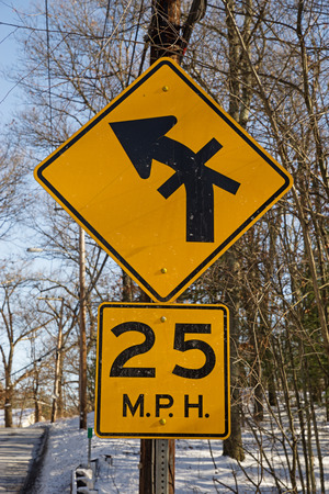 unusual complex intersection sign with 25 mph warning