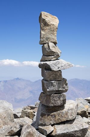 a rock tower at the summit of a mountain in the Sierra Nevada of California Stock Photo