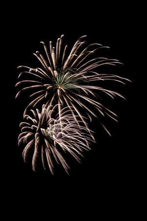 multiple fireworks explode with black background Stock Photo