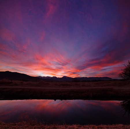 sunset in the Owens Valley near Bishop California with an irrigation canal