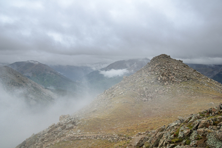 Sawatch mountains in Colorado wreathed in clouds and mist Banco de Imagens - 97124186