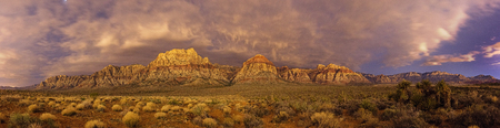 panorama of Red Rock Conservation Area at night lit by the glow from Las Vegas Stock fotó