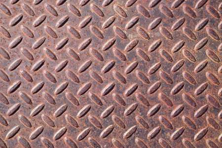 Rusty and worn old diamond tread background texture