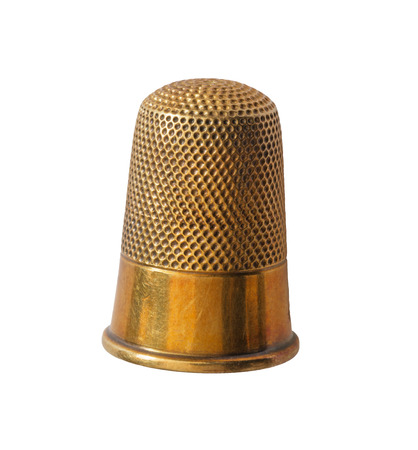 close up of brass thimble isolated on white background Archivio Fotografico