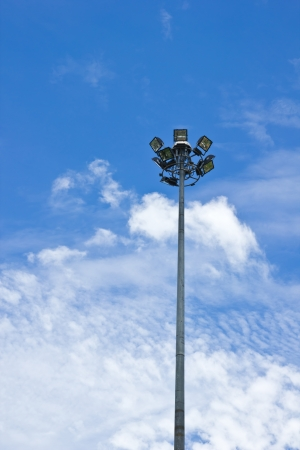 Spot-light tower in blue sky with clound