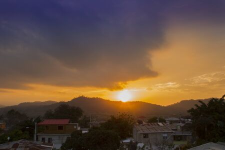sunset orange and yellow cumulus clouds in a summer day in a small village 版權商用圖片
