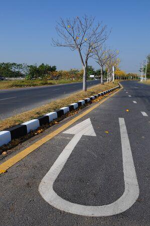 suface: u-turn arrow symbol on the asphalt road suface
