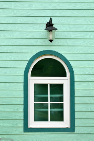 Vintage window on green cement wall can be used for background photo