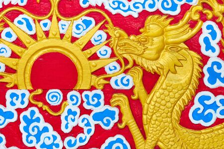 golden dragons in chinese style on red background photo