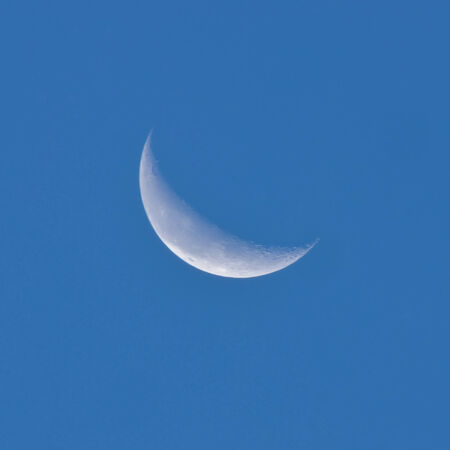 Crescent moon in the night sky photo