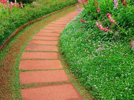 stone walkway in flower garden photo