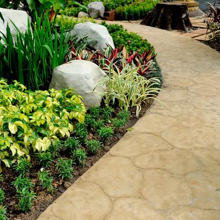 landscaped: stone walkway in garden