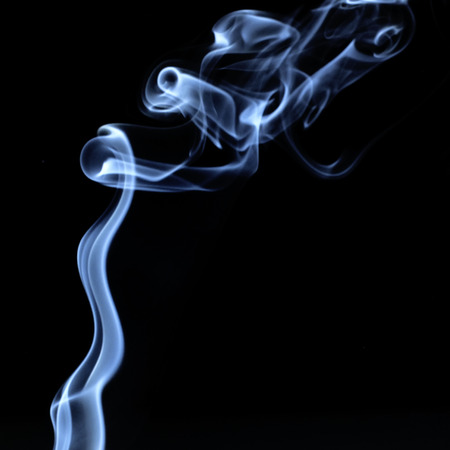firestarter: Ignition of match with smoke, isolated on black background